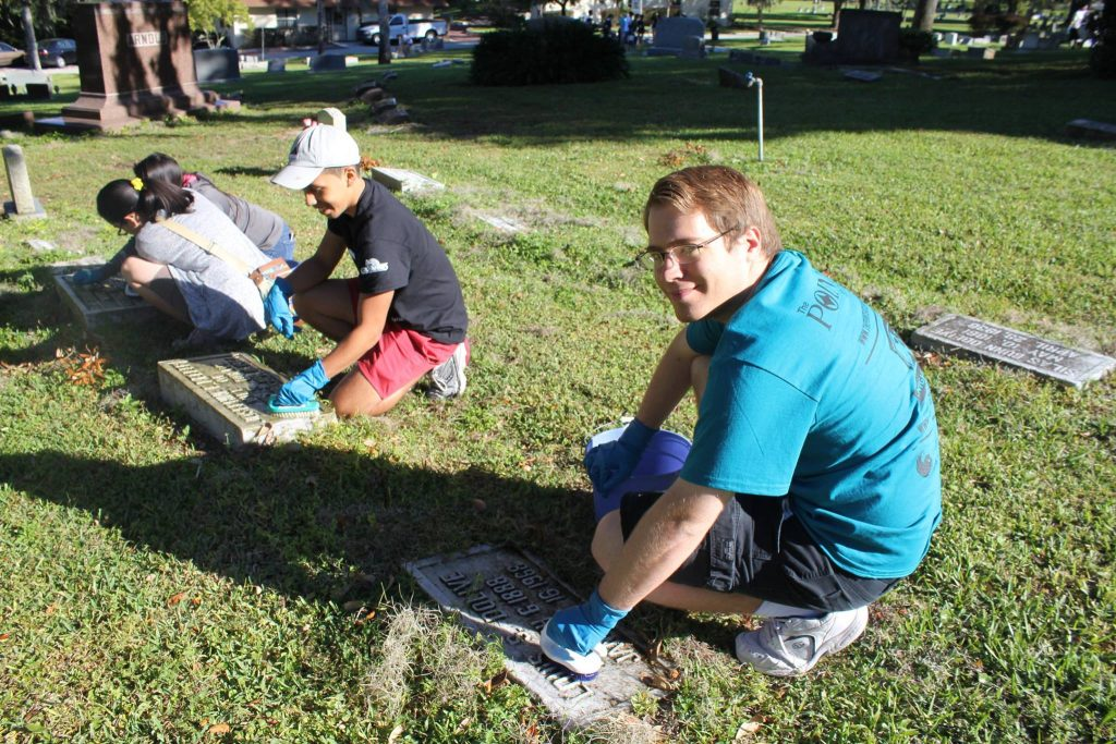 Cleaning headstones at Greenwood Cemetery