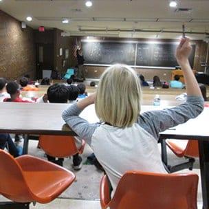 Student raising hand in class