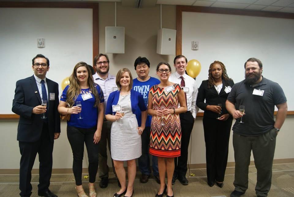 Doctoral graduates celebrating at the Ph.D. Pre-Commencement Celebration.