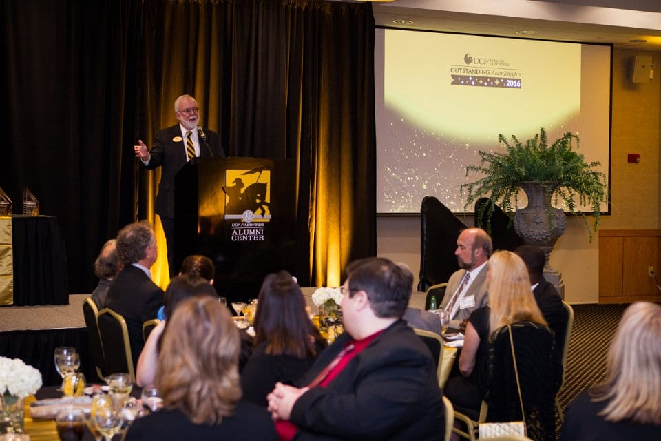 Dr. Michael Johnson, Dean of the UCF College of Sciences hosts the 2016 COS Outstanding AlumKnights awards reception.