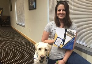 Amanda Overend '16 and dog-in-training Ridley.