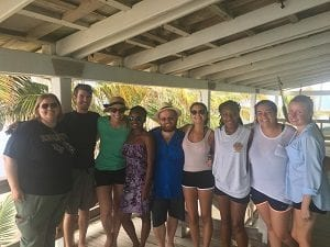 Left to Right: Rhena South, Nicholas Altizer, Mandi Barringer, Betty Pierre, Deven Gray, Alexis Yohros, Briana Robinson, Emily Clarke, Taylor Hanus A group photo of the UCF Belize Study Abroad Group at the Smithsonian Institute on Carrie Bow Caye learning more about the marine life and coral reef as well as some of the current research that is going on.