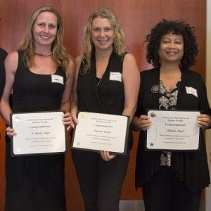 Cynthia Young (left) and Linda Walters (right) present awards to J. Marla Toyne, Shannon Carter and Belinda Boyd