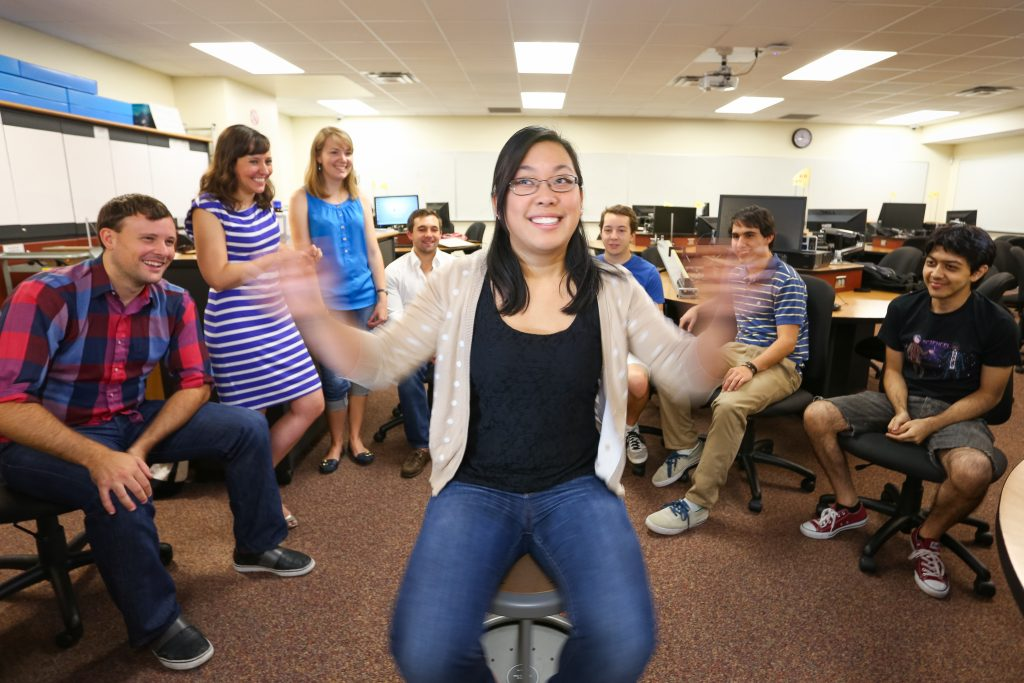 An LA demonstrates concervationangular momentum with a spinning stool.