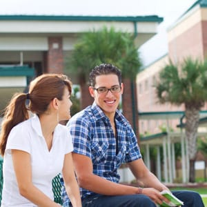 Students sitting on a bench talking